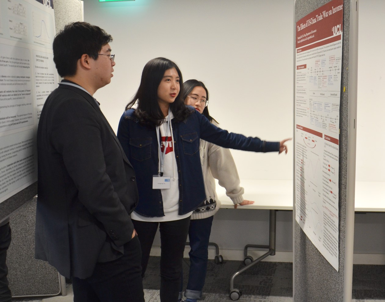 Fangning Hu and Yao Tong explaining their posters