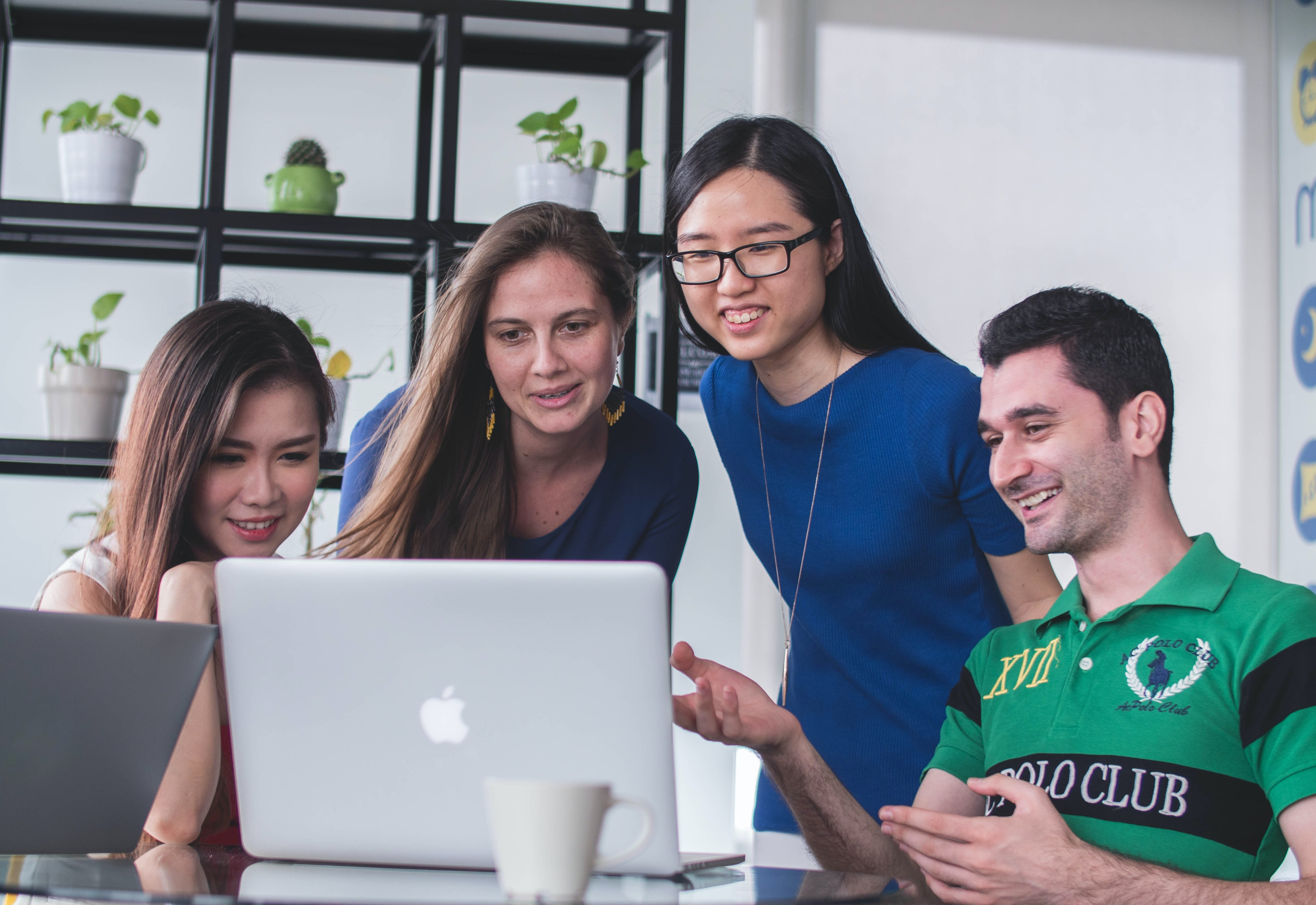 group of people around a laptop